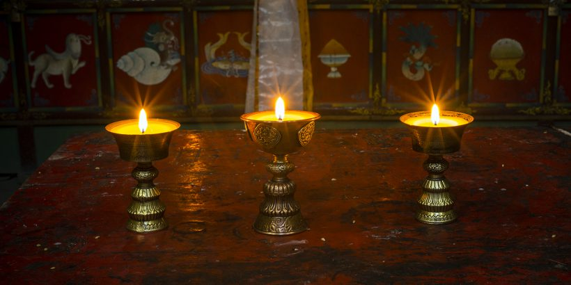 Altar with butter lamps in Buddhist monastery in Ghiling, Mustang, Nepal